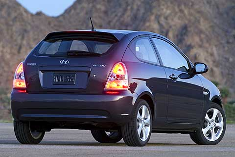 Exterior rear, side view of the 2007 Hyundai Accent Compact Economy 3-Door Hatchback Coupe