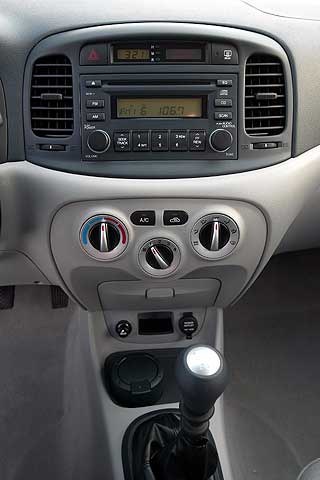Interior dash of the 2007 Hyundai Accent Compact Economy 3-Door Hatchback Coupe